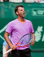 13-07-13, Netherlands, Scheveningen,  Mets, Tennis, Sport1 Open, day six, Marc Gicquel (FRA) screems out of frustration<br /> <br /> <br /> Photo: Henk Koster