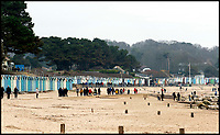 BNPS.co.uk (01202 558833)<br /> Pic:  RogerArbon/BNPS<br /> <br /> The view of Avon beach from the beach huts.<br /> <br /> A group of hardy souls combined two great British traditions to queue out overnight to secure a sought-after beach hut for the summer.<br /> <br /> Some 21 of the timber cabins at Avon Beach, Christchurch, Dorset, became available to rent for the whole year from 8am today.<br /> <br /> The huts are in such demand that people began queuing from 7.30am yesterday (Sun) to guarantee one.<br /> <br /> The stoic group swelled in size throughout the day and night when temperatures dropped to a freezing 2C.