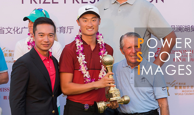 Li Haotong of China poses with the trophy after winning the World Celebrity Pro-Am 2016 Mission Hills China Golf Tournament on 23 October 2016, in Haikou, Hainan province, China. Photo by Weixiang Lim / Power Sport Images
