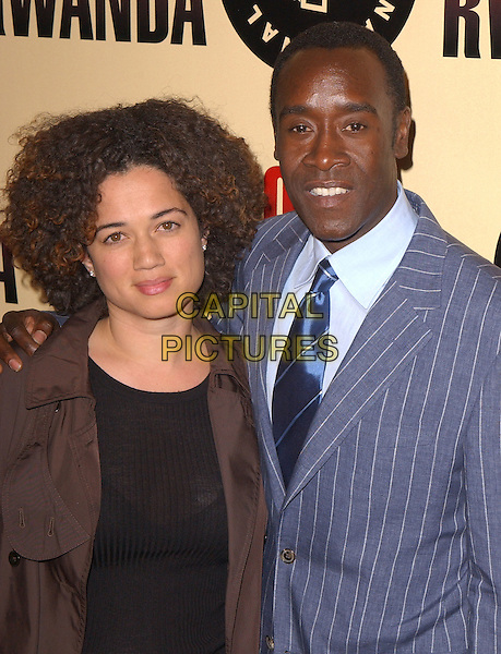 "DON CHEADLE.Los Angeles Premiere of ""Hotel Rwanda"" held at The Academy Theatre in Beverly Hills, California.December 2nd, 2004.half length, grey, gray pinstripe.www.capitalpictures.com.sales@capitalpictures.com.Supplied by Capital Pictures."