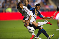 Alvaro Saborio (15) of Real Salt Lake goes over the leg of Carlos Valdes (2) of the Philadelphia Union. The Philadelphia Union and Real Salt Lake played to a 0-0 tie during a Major League Soccer (MLS) match at PPL Park in Chester, PA, on August 24, 2012.