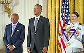 Berry Gordy, Record Producer & Songwriter of Los Angeles, California and United States President Barack Obama listen as the citation is read prior to presenting the 2015 National Medal of Arts during a ceremony in the East Room of the White House in Washington, DC on Thursday, September 22, 2016.<br /> Credit: Ron Sachs / CNP