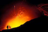 Spectators watch fiery lava fountaining as it enters the sea off the coast of the Big Island of Hawaii.