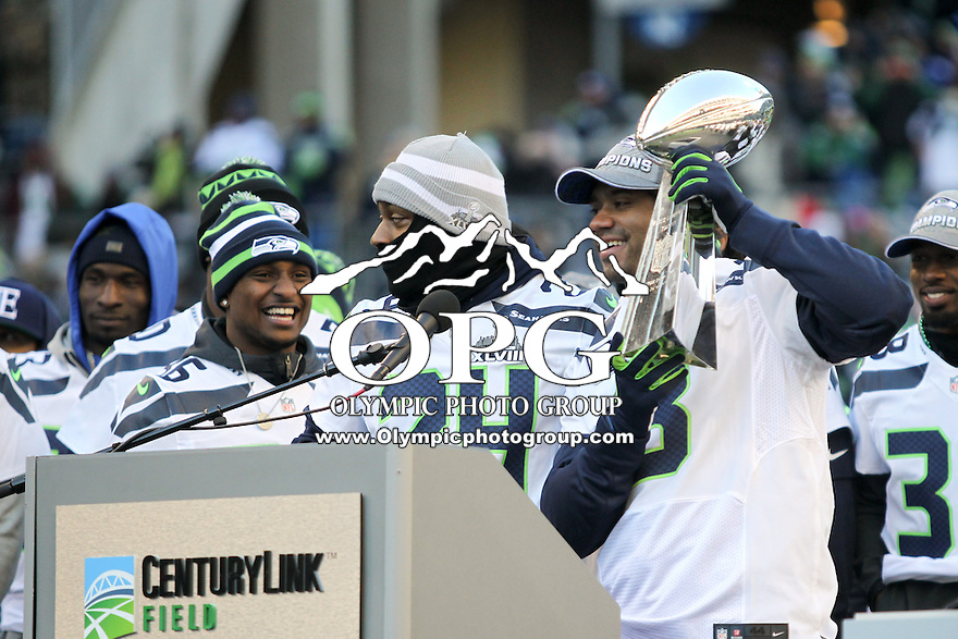 2014-02-05:  Seattle Seahawks quarterback Russell Wilson thanked the 12th man during the trophy celebration. Seattle Seahawks players and 12th man fans celebrated bringing the Lombardi trophy home to Seattle during the Super Bowl Parade at Century Link Field in Seattle, WA.