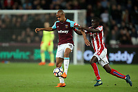 Papa Alioune Ndiaye of Stoke City and Joao Mario of West Ham United during West Ham United vs Stoke City, Premier League Football at The London Stadium on 16th April 2018