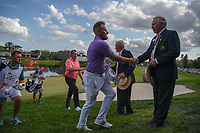 Tyrrell Hatton (ENG) shakes hands with the Arnold Palmer Invitational leadership following round 4 of the Arnold Palmer Invitational at Bay Hill Golf Club, Bay Hill, Florida. 3/10/2019.<br /> Picture: Golffile | Ken Murray<br /> <br /> <br /> All photo usage must carry mandatory copyright credit (© Golffile | Ken Murray)