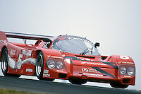 The Porsche 962 driven by Hans Stuck lifts a wheel during hard cornering in the 1986 IMSA GTP race at Mid-Ohio Sports Car Course near Lexington, Ohio.