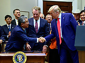 United States President Donald J. Trump, right, shakes hands with Ambassador Shinsuke Sugiyama, Ambassador of Japan to the US, left. after he signed the US-Japan Trade Agreement and US-Japan Digital Trade Agreement in the Roosevelt Room of the White House in Washington, DC on Monday, October 7, 2019.<br /> Credit: Ron Sachs / Pool via CNP