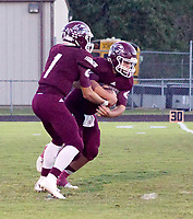 Photo by Randy Moll<br /> Jon Faulkenberry, Gentry quarterback, fakes a handoff to middle linebacker Myles McFerron before running around the left side during play against the Berryville Bobcats on Friday night in Gentry.
