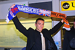 Fabrice Fernandes arrives for a stint at Rangers and is captures at Glasgow Airport