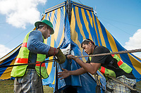 NWA Democrat-Gazette/BEN GOFF @NWABENGOFF<br /> Lucas Ricardo (left) and Nicholas Martinez help set up the big top tent Thursday, Sept. 6, 2018, for the Carson &amp; Barnes Circus at the Metroplex Event Center in Rogers. The 'Circus Saurus' shows, featuring a dinosaur theme along with traditional circus acts, begin tonight at 7:30 p.m. and continue Friday, Saturday and Sunday. The stop in Rogers was moved from it's planned location at Frisco Station Mall.
