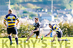 Iveragh Eagles Daragh Scanlon having scored the home sides first try pictured here on another run avoiding the hand trp from Dolphins Garry Ross.  Iveragh Eagles 22 Dolphin 20.