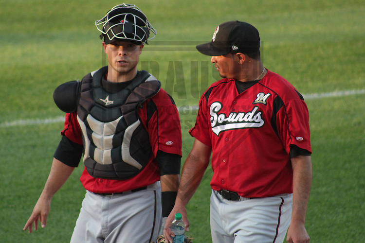 DES MOINES - May 2012: Dayton Buller (17) and Amaury Rivas (46) of the Nashville Sounds, Triple-A affiliate of the Milwaukee Brewers, during a game against the Iowa Cubs on June 9, 2012 at Principal Park in Des Moines, Iowa. (Photo by Brad Krause). ..