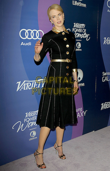 Nicole Kidman<br /> Variety's 5th Annual Power Of Women Event held at the Beverly Wilshire Four Seasons Hotel, Beverly Hills, California, USA, <br /> 4th October 2013.<br /> full length black velvet gold dress coat buttons belt collar strappy sandals hand waving <br /> CAP/ADM/KB<br /> &copy;Kevan Brooks/AdMedia/Capital Pictures