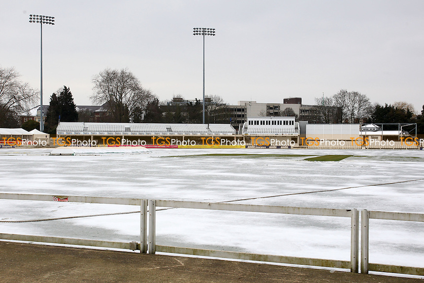 Snow covers the outfield at the Essex County Ground in Chelmsford bringing about the postponement of a scheduled friendly match between Essex CCC and Worcestershire CCC - 25/03/13 - MANDATORY CREDIT: Gavin Ellis/TGSPHOTO - Self billing applies where appropriate - 0845 094 6026 - contact@tgsphoto.co.uk - NO UNPAID USE.