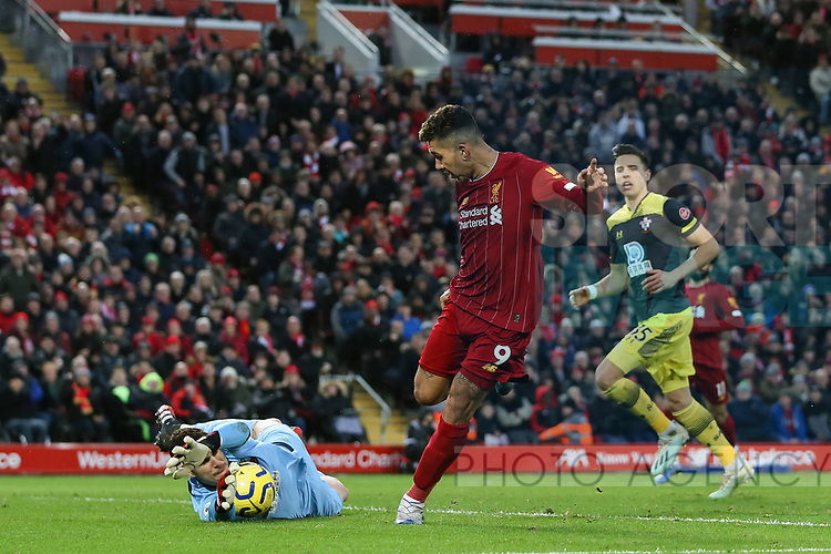 Alex McCarthy of Southampton saves a shot from Roberto Firmino of Liverpool during the Premier League match at Anfield, Liverpool. Picture date: 1st February 2020. Picture credit should read: James Wilson/Sportimage