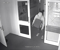 Business owner watches burglary on her mobile.