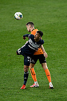 29th July 2020; Bankwest Stadium, Parramatta, New South Wales, Australia; A League Football, Melbourne Victory versus Brisbane Roar; Birkan Kirdar of Melbourne Victory and Macaulay Gillesphey of Brisbane Roar challenge for the loose ball