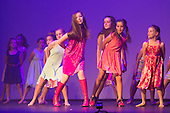 St Albans, England. 8 August 2015. Students aged 5 to 18 from the Living the Dream School of Performing Arts/The Dream Foundation perform in the annual Summer Showcase - street dance, contemporary dance, acting, musical theatre and singing - at the Albans Arena. The whole production is a variety showcase created entirely by young people who want to make a difference through the arts, have fun, grow in talent and confidence and feel empowered to believe in themselves and their dreams. The Dream Foundation was set up by Zoe Jackson. Photo Credit: Bettina Strenske