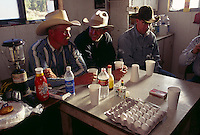 Cowboys talk over breakfast in the bunkhouse at Beef Basin in southeastern Utah before moving cattle across public lands where ranchers pay for grazing rights.
