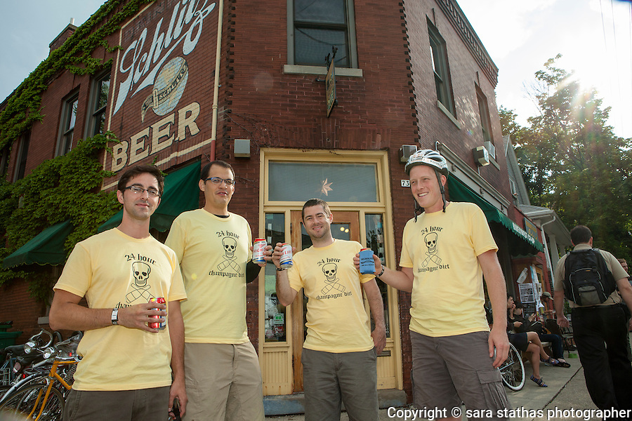 """The 24hr Champagne Team drinking Miller High LIfe, """"The Champagne of Beers"""" before the start of the ride"""