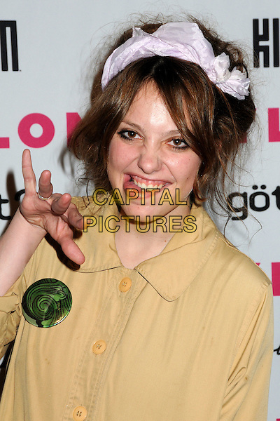 COREY KENNEDY.Nylon Magazine's Young Hollywood Party held at the Roosevelt Hotel's Tropicana Bar, Hollywood, California, USA..May 12th, 2010.headshot portrait yellow beige top pink headband hairband hair head band eyeliner green pattern badge button half length hand gesture mouth open tongue funny face .CAP/ADM/BP.©Byron Purvis/AdMedia/Capital Pictures.