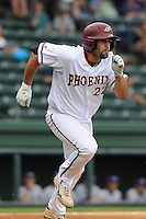 Junior first baseman Ryan Kinsella (22) of the Elon Phoenix bats in a first-round Southern Conference Tournament game against the Furman Paladins on Wednesday, May 22, 2013, at Fluor Field at the West End in Greenville, South Carolina. Kinsella was voted the 2013 Southern Conference Player of the Year by the league's coaches. Furman won, 10-1. (Tom Priddy/Four Seam Images)