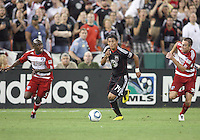 Andy Najar #14 of D.C. United cuts between Jair Benitez #5 and Eric Alexander #24 of FC Dallas during an MLS match at RFK Stadium in Washington D.C. on August 14 2010. Dallas won 3-1.