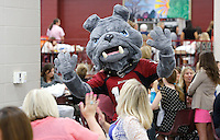 NWA Democrat-Gazette/DAVID GOTTSCHALK  The Springdale High School Red Bulldog mascot greets elementary teachers and faculty members of the Springdale School District during the annual appreciation breakfast at Springdale High School Monday, August 10, 2015. The teachers received items from vendors, ate breakfast and participated in a welcoming program.