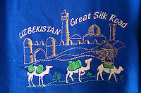 Uzbekistan, Bukhara. Abdul Aziz Khan Medressa. Souvenir shops in students' cells. Silk Road t-shirt.