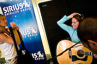 NEW YORK - APRIL 19: Deena Carter, right, gets ready to perform at Sirius Headquarters on April 19, 2005 in New York City. (Photo by Landon Nordeman)