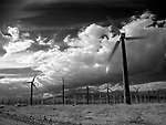 ©2002 David Burnett/Contact Press Images.Row upon row of electric producing windmills cover the terrain just north of Palm Springs, CA. Hundreds of windmills have been built here, in a natural valley which provides an almost constant wind.  This is one of the earliest experimental areas in the U.S. trying to harness wind as a form of energy. .