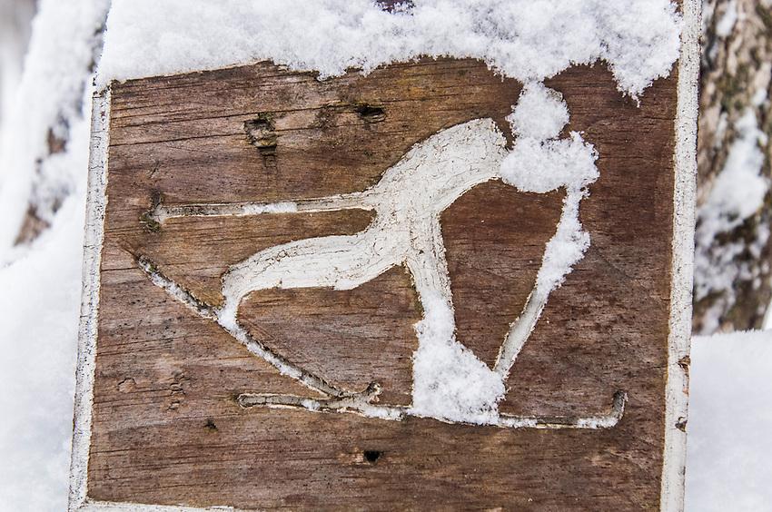 Ski trail signage with fresh snow.