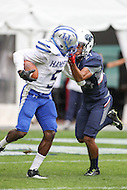 Washington, DC - September 16, 2016:Hampton Pirates wide receiver Twarn Mixson (5) gets facemasked by Howard Bison defensive back Alonte Dunn (21) during game between Hampton and Howard at  RFK Stadium in Washington, DC. September 16, 2016.  (Photo by Elliott Brown/Media Images International)