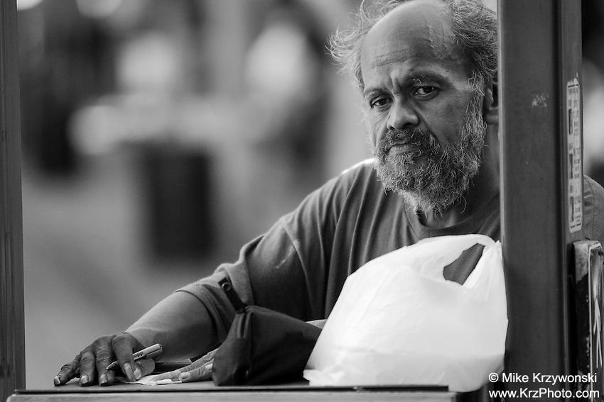 Homeless Hawaiian man in Chinatown, downtown, Honolulu, Hawaii, Oahu