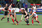 Glasgow 2014 Commonwealth Games<br /> Wales v England<br /> Sarah Jones takes on England pair Laura Unsworth and Lily Owsley.<br /> Glasgow National Hockey Centre<br /> <br /> 24.07.14<br /> ©Steve Pope-SPORTINGWALES