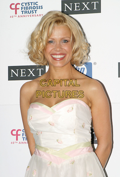 MELINDA MESSENGER.Breathing Life Awards - Presented By The Cystic Fibrosis Trust. Royal Lancaster Hotel, London.April 29th, 2004.headshot, portrait, strapless, ribbons.www.capitalpictures.com.sales@capitalpictures.com.© Capital Pictures.