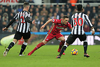 Connor Roberts of Swansea City (C) against Ciaran Clark (L) and Christian Atsu of Newcastle (R) during the Premier League match between Newcastle United and Swansea City at St James' Park, Newcastle, England, UK. Saturday 13 January 2018