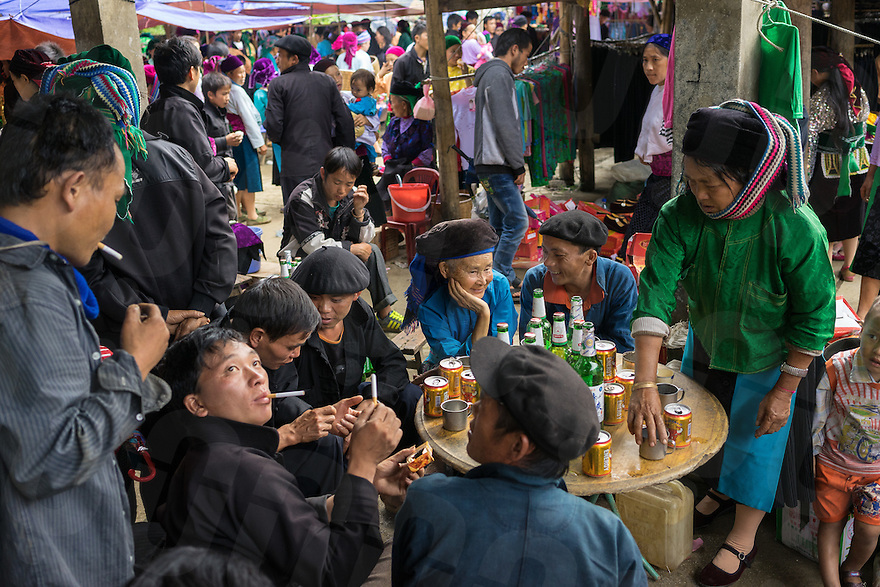 September 19, 2014 - Dong Van (Vietnam). Locals drink beers and rice wine at the local market of Saphin, a few kilometers outside Dong Van. © Thomas Cristofoletti / Ruom