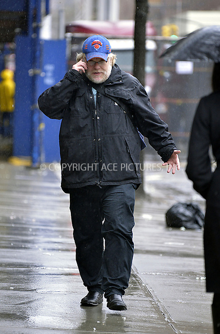 WWW.ACEPIXS.COM....February 27 2013, New York City....Actor Philip Seymour Hoffman walks around the West Village in the rain on February 27 2013 in New York City......By Line: Curtis Means/ACE Pictures......ACE Pictures, Inc...tel: 646 769 0430..Email: info@acepixs.com..www.acepixs.com