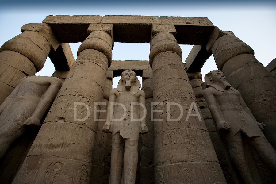 Stone statues of Ramses II inside the Luxor Temple on the East Bank of Luxor, along the Nile River, Egypt.