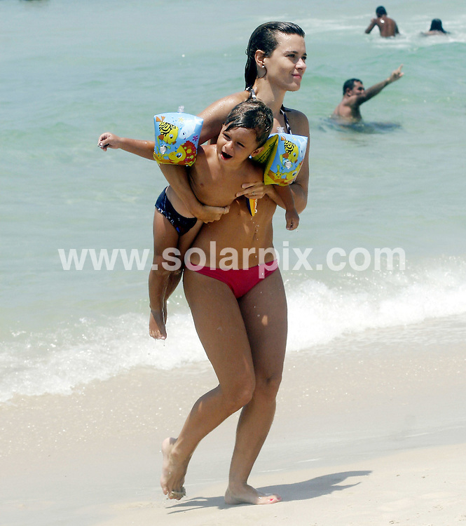 **ALL ROUND EXCLUSIVE PICTURES FROM SOLARPIX.COM**.**SYNDICATION RIGHTS FOR UK AND SPAIN ONLY**.Sexy Brazilian actress Carolina Dieckmann, 31, was spotted enjoying Pepe beach, in Rio, with her sons, Davi, 11 and Jose, 2 (from separate marriages). She was seen with fellow Brazilian actor and TV presenter Bruno De Luca, 27. Rio de Janeiro, Brazil. 12 January 2010..This pic: Carolina Dieckmann..JOB REF: 10457 PRT Soalheiro      DATE: 12_01_2010.**MUST CREDIT SOLARPIX.COM OR DOUBLE FEE WILL BE CHARGED**.**MUST NOTIFY SOLARPIX OF ONLINE USAGE**.**CALL US ON: +34 952 811 768 or LOW RATE FROM UK 0844 617 7637**