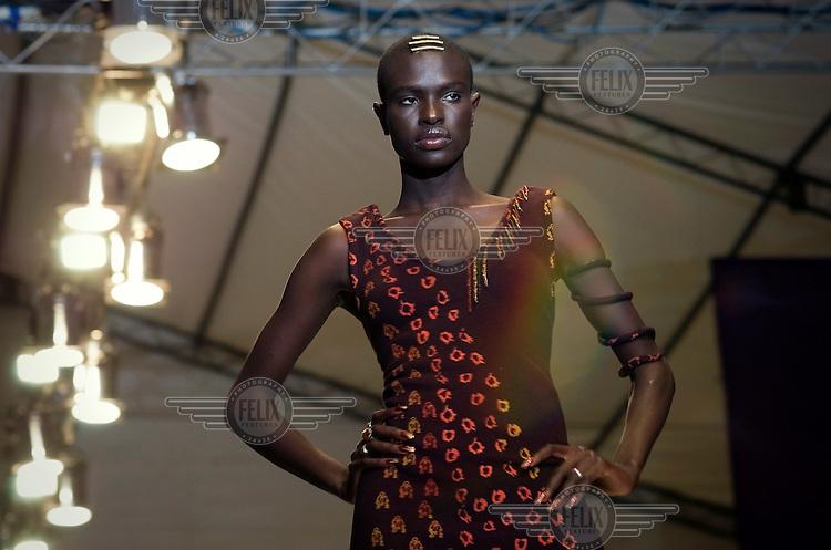 Turkana model Nancy Ajuma Nasenyana is pictured on the catwalk during Kenyan Fashion Week.