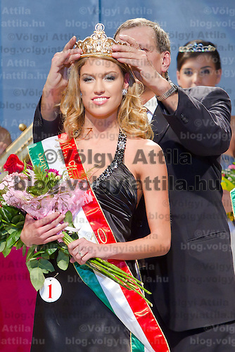 Dora Gregori (center) is being crowned during the Miss Hungary 2010 beauty contest held in Budapest, Hungary on November 29, 2010. ATTILA VOLGYI