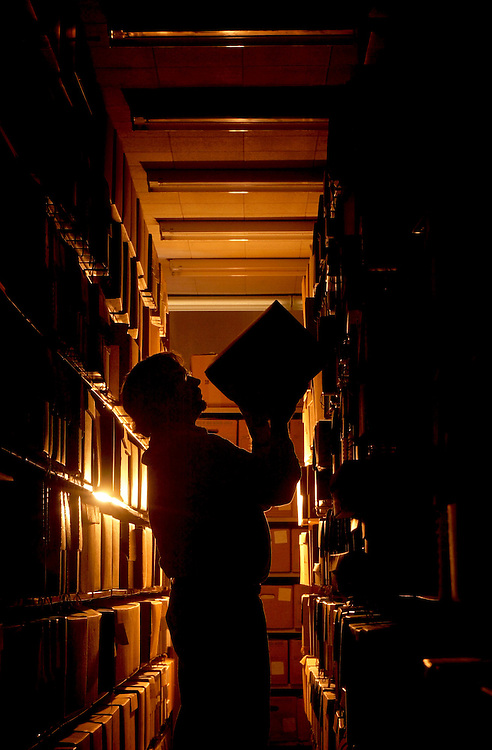 Bill Kimok Working in Stacks of Archives: Env. Portrait: Cutler Chest photo