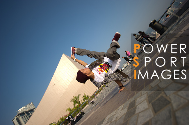 B-Boy Ronnie in action on Hong Kong's Victoria Harbour waterfront.