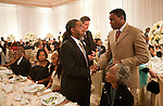 Carl Lewis, Olympic gold medalist, shakes hands with Newton Richards, Sanya's father, during the reception dinner at the Four Seasons Hotel. Olympic gold medalist, Sanya Richards, and New York Giants cornerback, Aaron Ross, wed at the Hyde Park Baptist in Austin, Texas on Friday, February 26, 2010...