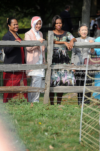 United States First Lady Michelle Obama, right center, visits Stone Barns Center in Pocantico Hills, New York on Friday, September 24, 2010 with a large group of other First Ladies visiting New York for the United Nations General Assembly. They viewed the mobile chicken coop and herb garden while making a tour of the facilities.  Also visible in the photo are: Hayrunnisa Gul of Turkey, left center, and Ban Sootaek of the UN at right..Credit: Andrea Renault / Pool via CNP
