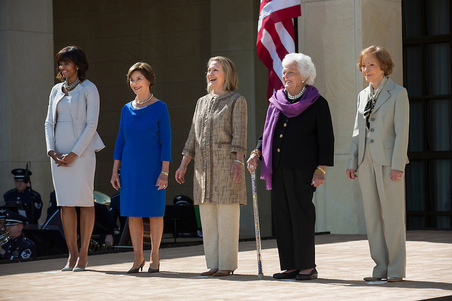 U.S. First Lady Michelle Obama (L) poses with former first ladies (2nd L-R) Laura Bush, Hillary Clinton, Barbara Bush and Rosalynn Carter as they attend the dedication ceremony for the George W. Bush Presidential Center in Dallas