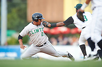 Clinton LumberKings third baseman Ramon Morla #22 is tagged out by Daniel Mateo #3 in a rundown during a Midwest League game against the Kane County Cougars at Fifth Third Ballpark on August 16, 2012 in Geneva, Illinois.  Kane County defeated Clinton 5-3.  (Mike Janes/Four Seam Images)